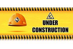 Hard Hat on Under Construction Board Stock Photo