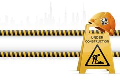 Hard hat on Under Construction Signboard Stock Image