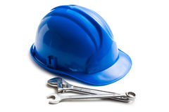 Hard hat with various working tools Stock Photo