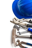 Hard hat with various working tools Stock Photography