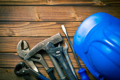 Hard hat with various working tools Royalty Free Stock Photos