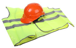 Hard hat and vest. Construction hard hat and high visibility vest on a white background stock photography