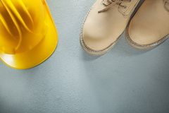Hard hat waterproof safety boots on concrete background Royalty Free Stock Photo