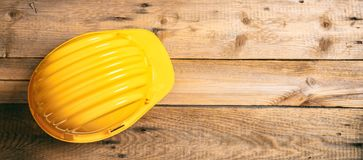 Hard hat on wooden background, copy space, top view Royalty Free Stock Photo