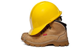 Hard Hat and Work Boots. Construction PPE - Steel toe boots and a yellow hard hat Stock Images