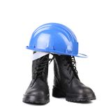 Hard hat and working boots. Stock Image