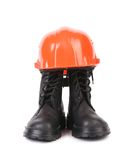 Hard hat and working boots. Royalty Free Stock Photo