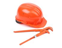 Hard hat and wrench close up. Royalty Free Stock Images
