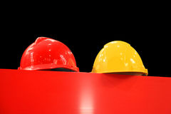 Hard hats on a black background Royalty Free Stock Photos