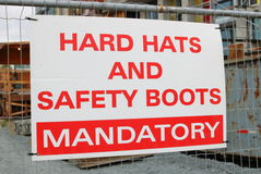 Hard hats and safety boots sign Stock Photos