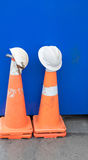 Hard hats and traffic cones. Used hard hats and traffic cones at a construction site. Photographed in Auckland, New Zealand, NZ royalty free stock images