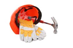 Hard head gloves and hammer. Royalty Free Stock Photography