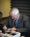 Hard Knocks. Howie Carr autographing copies of his book Hard Knocks. 3-2-13 at WRKO Town Hall Event held at the WGBH auditorium Boston , Massachusetts- sponsored Stock Image