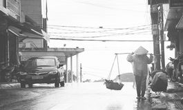 Hard Life!. I took this when walking in Dalat city. A tourist city in Vietnam and there are a lot of both rich people and poor at the same place Stock Photography