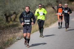 Hard marathon mountain race, road Stock Photos