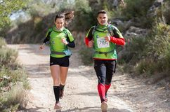 Hard mountain race, friends Royalty Free Stock Images