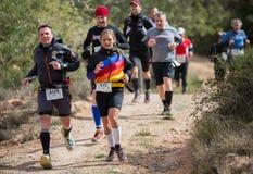 Hard mountain race, friends Stock Photography