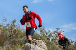 Hard mountain race, friends Royalty Free Stock Photo