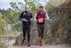 Hard mountain race, friends Royalty Free Stock Image