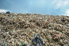 Hard plastic garbage decomposition. Pollution from the consumer society. Hard plastic garbage decomposition. Pollution and management burden Environmental Royalty Free Stock Image