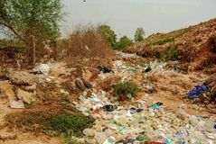 Hard plastic garbage decomposition. Pollution from the consumer society. Hard plastic garbage decomposition. Pollution and management burden Environmental stock photos