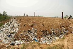 Hard plastic garbage decomposition. Pollution from the consumer society. Hard plastic garbage decomposition. Pollution and management burden Environmental Stock Photo