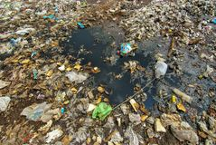 Hard plastic garbage decomposition. Pollution from the consumer society. Hard plastic garbage decomposition. Pollution and management burden Environmental Royalty Free Stock Photos