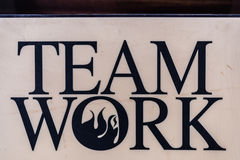"Hard plastic plate with word ""team work"". Royalty Free Stock Photos"