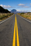 Hard road ahead. Long straight road to mt doom mountain, new zealand Royalty Free Stock Photography