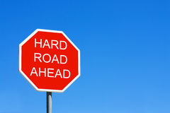 Hard Road Ahead. Road sign against a clear blue sky Stock Image