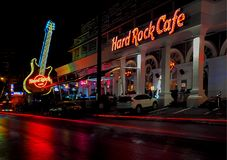 Hard Rock Cafe music club. Neon guitar and blurry car traffic in front of the Hard Rock Cafe music club in the city of Fhuket in Thailand stock photo
