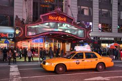 Hard Rock Cafe on Times Square, New York City. Yellow Cab in front of Hard Rock Cafe on Times Square at night, Manhattan, New York City, USA Stock Photography