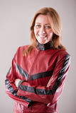 Hard rock woman in red leather jacket Royalty Free Stock Photos