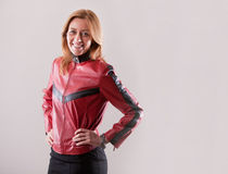 Hard rock woman in red leather jacket Royalty Free Stock Image