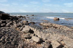 Hard rocky coastine Stock Photos