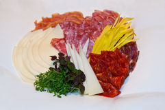Hard salami meat appetizer. Hard salami appetizer plate in southern Serbia style Stock Photo