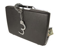 Hard-shell briefcase and handcuffs Stock Image