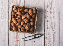 Hard shell fruits on a basket a wooden background Stock Photography