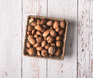 Hard shell fruits on a basket a wooden background Royalty Free Stock Images