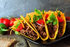 Hard shelled tacos with ground beef, vegetables and cheese, close up scene Royalty Free Stock Photography