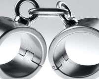 Hard steel handcuffs Royalty Free Stock Images