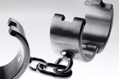 Hard steel handcuffs Stock Photos