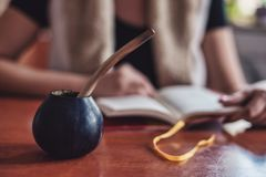 Hard studying with yerba mate stock images