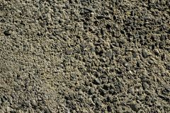 Hard surface texture background of shade of grey cement and stone pavement road ground under sunlight Stock Images