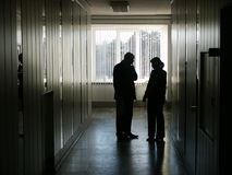 Hard talk. In office corridor, silhouette Stock Image