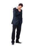 Hard Thoughts. Full length portrsit of a young thoughtfull businessman, looking down Stock Image