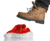 Hard times at christmas. Workboot stomping on santa hat - hard times at christmas