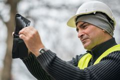 Bad times: poor construction worker and his empty wallet Royalty Free Stock Image