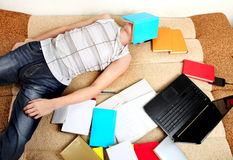Hard Tired Student on Sofa Stock Photo