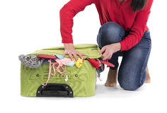 Hard  to pack a suitcase. Stock Photo